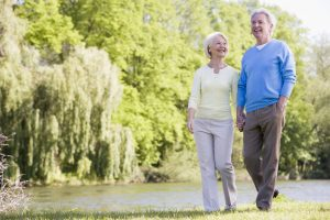 Senior couple strolling outdoors on a spring day. Staying physically active through the years is an important key to overall well-being and longevity.