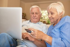 Senior couple shopping online. Online shopping offers ease and convenience.