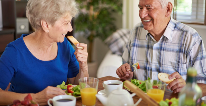 Senior couple enjoying a meal together. As we age, it is very common to lose our sense of taste for a variety of reasons.
