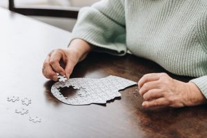 Senior woman doing a puzzle. Dementia is a medical condition that affects roughly 50 million people throughout the world.