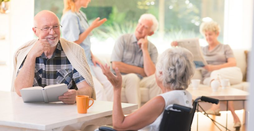 Residents of a senior living community, chatting over coffee and tea.